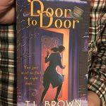 Paperback copy of Door to Door by TL Brown